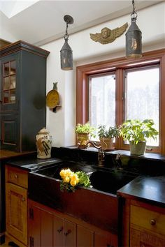 Soapstone Sink & Antiqued Cabinetry