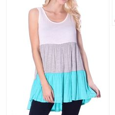 """Blue, Grey, & White Tiered Tank Blue, Grey, & White Tiered Tank.  97% Rayon, 3% Spandex.  Scoop neck with a trendy tiered design.  Sizes- Sm-Med-Lg.   Sizes are as followed (underarm to underarm, top of shoulder to bottom of hem):  small- 16"""", 29"""". Medium- 17"""", 29"""".  Large- 18"""", 31"""". Tops Tank Tops"""