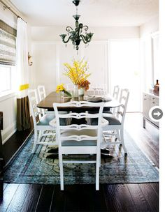 Informal and eclectic. Love the over dyed rug.