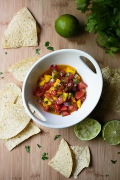This mango salsa is a blend of sweet and spicy, and it's perfect served with chips, fish tacos, and quesadillas // thiswildseason.com