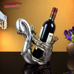 https://www.aliexpress.com/store/product/High-end-business-gifts-resin-old-antique-gold-diamond-ornaments-Swan-wine-rack-study-office-decor/219022_32737231547.html?spm=2114.12010608.0.0.ZgyEr4Find More Figurines & Miniatures Information about 2016 Promoti