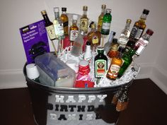 """A """"Happy 21"""" basket.  Contains: 21 mini bottles, Tylenol, First Aid Kit, Pepto, ping pong balls, fake Mustaches (to make him look older), scope, hard candy, 24 pack of red solo cups duct taped to the back, ice bag (for headaches), mini flask, and a ring with a bottle opener built in."""