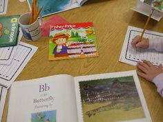 A variety of alphabet books are laid out for this center and children look through these books and find a word for each letter and write the words down in alphabetic order on a sheet of paper.
