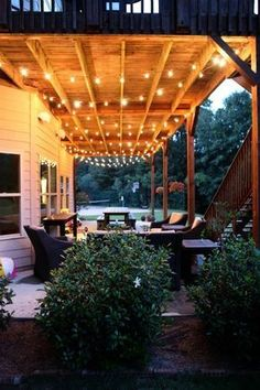 The dull and dark place under a back deck and brighten up with lighting and furniture. More Backyard Ideas on Frugal Coupon Living.