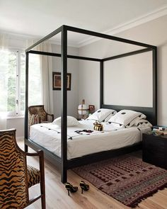 canopy-bed-black-painted-white-walls-tiger-striped-animal-print-chairs-decorating-ideas-bedroom
