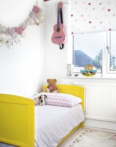 Choose small-scale furniture for kids for bedroom or playroom. For an elegant but still playful look, add pattern to a white bedroom scheme - the mix of dots and checks in this room is delightful