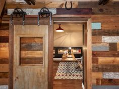 A sliding door saves space and can add a charming rustic look to your home.  Upcycle an old door from a salvage shop and the materials should cost you no more than $100!