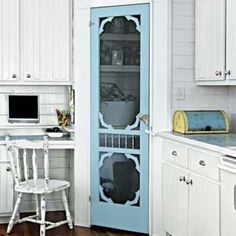 Very unique idea for a pantry door...it brings a southern charm to the kitchen. Love this!