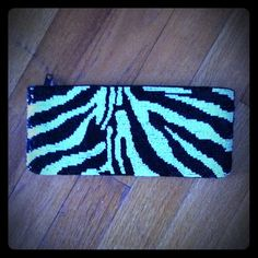 Beautiful beaded tiger stripe clutch Beautiful beaded tiger stripe clutch ... Tres chic! 9 in long 3 inches wide Neiman Marcus Bags Clutches & Wristlets
