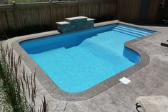 Square L Inground Pool with Full Crystal Liner, Sheer Descent Waterfall, Lighting System, and Vinyl Over Steel Steps. Check out the full Pool Showcase here. Cheap Inground Pool, Vinyl Pools Inground, Backyard Pool Landscaping, Small Backyard Pools, Small Pools, Landscaping Tips, Backyard Ideas, Backyard Retreat, Patio