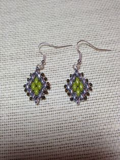 Earrings.  I love these Silver super duos!