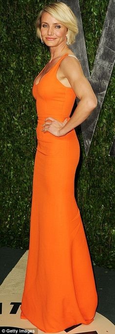 Eye-popping orange: Cameron Diaz slipped into a bright orange Victoria Beckham design for the Vanity Fair Oscars after-party at the Sunset Tower hotel last night