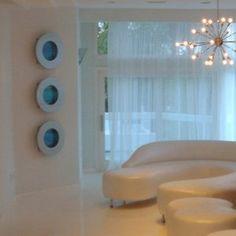 Those circles on the wall are fish tanks! Bayshore+Round+Flat+Glass+Aquarium+-+2.3+Gallon