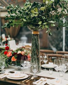 """Vases full of tall greenery were set on the tables at this November wedding. """"It just looked so beautiful, not too fussy and wonderfully unexpected,"""" says the bride."""