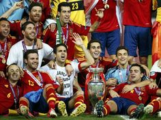 Spain's team players celebrate with the trophy after defeating Italy to win the Euro 2012 final soccer match at the Olympic stadium in Kiev, July 1, 2012.