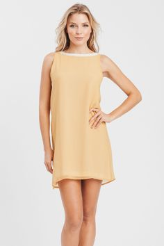 Tang shift dress with low back encrusted details. Lined Fabrication: 100% Polyester Dry clean. Made in U.S.A. Available colors: Tang