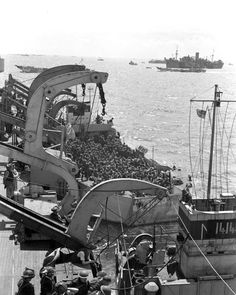 A second section of infantrymen preparing to go ashore from H.M.C.S. PRINCE DAVID off Bernières-sur-Mer, 6 June 1944.