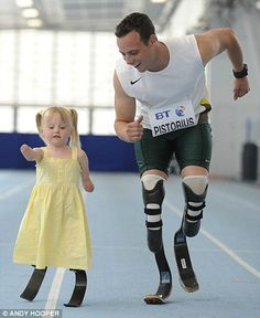 Oscar Pistorius, the first amputee ever to compete in track and field at the Olympics, teaching a little girl how to race.