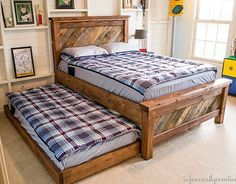 WEBSTA @ infarrantlycreative - I still smile every time I walk in my son's room and see this DIY Farmhouse Bed with Rolling Trundle I made. It is perfect in every way for my 10 year old. Free plans - direct link in profile. http://www.infarrantlycreative.net/farmhouse-pallet-bed-with-rolling-trundle/