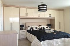 Overbed wardrobe storage units and cabinets