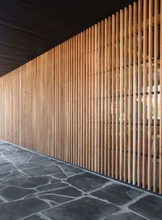 An empty concrete and glass shell was transformed into a warm, highly textural space with extensive use of natural materials including; American white oak, black Spanish marble, off-form concrete and a splash of red furniture. Timber Screens, Timber Slats, Wood Facade, Timber Cladding, Privacy Fence Designs, Slat Wall, Architecture Design, Backyard, White Oak