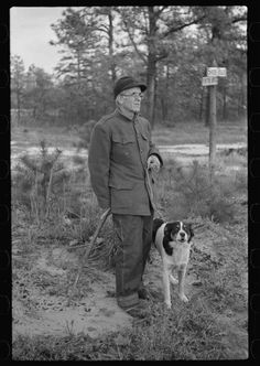Farmer with his dog in cut-over area, New Jersey. (1938.)