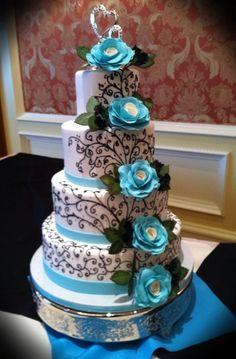 Black scrolling wedding cake