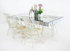 Coco Dining Table The very sleek mirror polished stainless steel