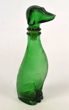 A kitsch & chic emerald green glass dog bottle.