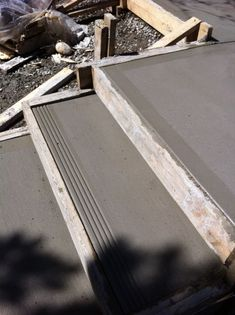 Broom finish concrete step with 4 grooved edge. By Dan forsythe