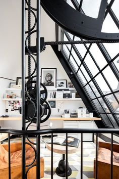 The most arresting feature of this four-bedroom townhouse in the West Village is probably the steel and glass atelier that's perched atop the building. Inspired by the Maison de Verre (French for. Wrought Iron Staircase, Townhouse Designs, West Village, Office Interior Design, Lofts, Rooftop, Planer, Home Decor, Disco Ball