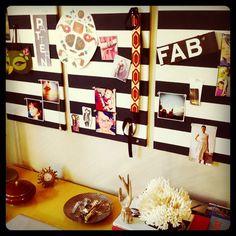 Whoorl's inspiration board - fabric covered corkboard.  Love!