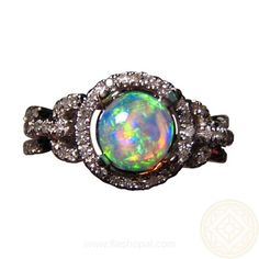 Opal Ring with Diamonds in 14k Gold with one round mainly Green Opal.  The Crystal Opal is round and is surrounded by a halo of small quality Diamonds.  The band is gold links studded with pave diamonds.  Suitable as a dress ring or opal engagement ring.  #opalring #opalengagementring #flashopal