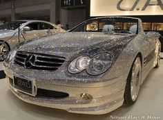 This is a blinged out car. This is a car I should drive. This is a car that would last 2 minutes parked on the road before it is stripped of all of it's bling.