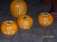 Carve your monogram into the pumpkins and then put candles inside