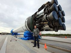 SpaceX CEO Elon Musk stands next to the company's Falcon 9 rocket, which blasted SpaceX's Dragon capsule into orbit in December 2010.