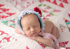 Newborn girl criss-cross pose vintage rose quilt aqua, fuchsia, pink  |  Bella Rose Portraits San Diego County newborn and baby photographer photography posing techniques Oceanside, CA