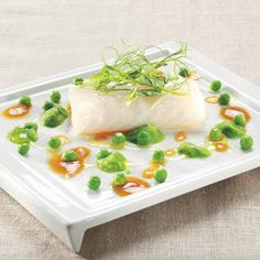 Baked cod with vegetable broth reduction and fresh peas. (gluten free recipe by D. Zennaro)