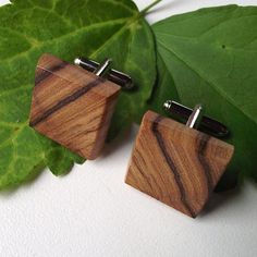 Wooden cuff links. If I ever got into cuff links these would be the ones.