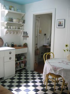 Eat in kitchen, retro black & white checkerboard floor, open shelving