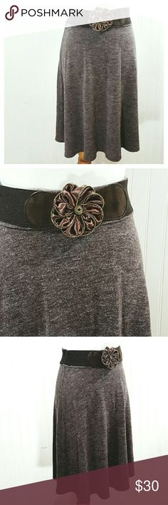 Mocha Wool Skirt with Belt Beautiful wool skirt, mocha brown, mid-length A-line style, zipper back, brown stretch belt with flower buckle.  100% wool skirt, polyester lining, belt.  Brand new with tags.  Size Medium. Lapis Skirts Midi