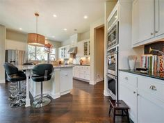 Top of the line appliances, white cabinetry and wood floors 7616 Lenape Trl, Austin, TX 78736