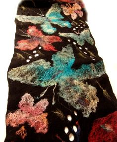Pretty felted scarf -- I love the blues and reds and how it reveals into butterflies