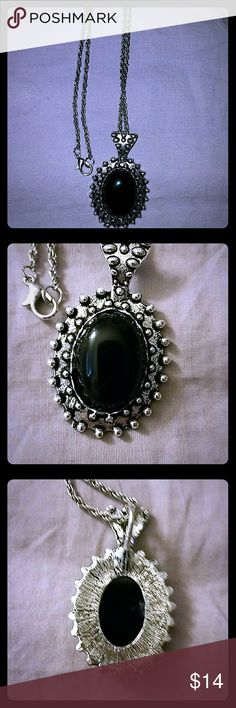 NEW! *Long Silver-Toned Onyx Necklace* This necklace is meant to be quite lengthy and looks great and makes a simple yet bold statement with a maxi dress for example. The chain is approx. 14 in. when clasped. The black & silver-toned pendant is 2 inches long and 1 in wide. Jewelry Necklaces