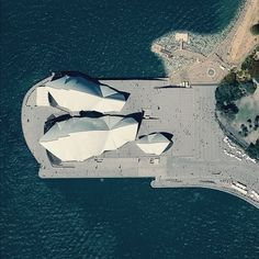 "The Sydney Opera House hosts more than 1,500 shows each year in its various performance halls, drawing a total attendance of approximately 1.2 million people. While the buildings famous ""shell"" design appears uniformly white from a distance, it actually features a subtle chevron pattern composed of tiles in two colors: glossy white and matte cream."