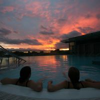 Thermae Bath Spa rooftop pool at Sunset with Orchid City & Spa