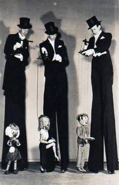Pelham puppets Jean and Peter Barbour interesting performsnce concept... exposed; on stilts