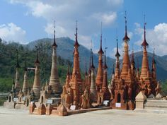 This cluster of stupas at Shwe Inn Dein southwest of Inle Lake, Myanmar (Burma), awaits gilding by karma-craving donors. Inle Lake, Vacation Places, Statue Of Liberty, Tourism, Fair Grounds, Australia, Karma, Travel, Blog