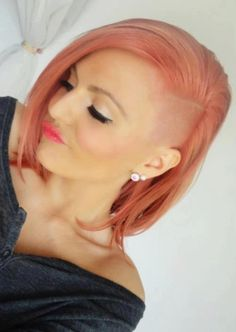 Half-shaved and side swept hairstyle with soft pink colouring