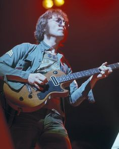 """On the day that would have been his 75th birthday, we salute John Lennon with a photo of him performing at Madison Square Garden in 1972. Lennon brought us wit as well as inspiration: Before the former Beatle launched into the song """"Mother,"""" he joked, """"This song is another song from one of those albums I made since I left The Rolling Stones."""" (Photo Credit: From the Lens of George Kalinsky)  #JohnLennon #HappyBirthdayJohnLennon"""